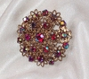 Goldtone Pin with Red/Purple AB Stones
