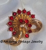 Goldtone Swirl Pin w/Red RS