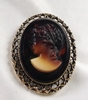 Large Goldtone Frame - Root Beer Glass Cameo Pin