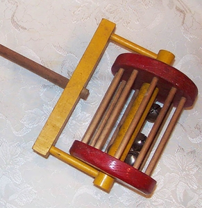 Primitive Wooden Push Toy - Musical