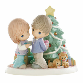 PRECIOUS MOMENTS CHRISTMAS LIMITED EDITION:  HOLIDAY SURPRISES ARE FILLED WITH LOVE