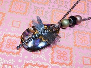 Dragon fly Resting on the rock Jesus. necklace