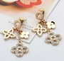 Gold Plated Dangling Pave Clover Earrings -