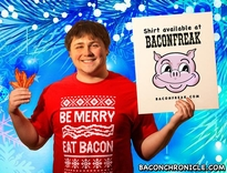 """Bacon Chronicle featured our """"Be Merry, Eat Bacon"""" holiday t-shirt."""