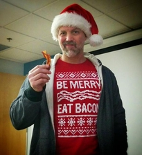 "Here's a fan wearing our ""Be Merry, Eat Bacon"" holiday t-shirt."
