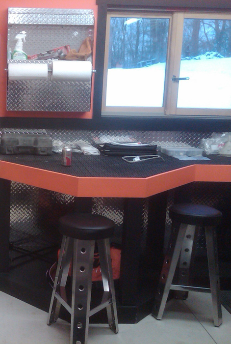 Two Comfy Red Checkered Bar Chairs And Compact High Top Table