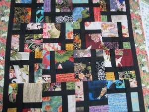 Quilt Using Debsews Charms by Joan in CA