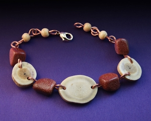 Handcrafted Deer Antler Bracelet with Sun Stone and Bone Beads