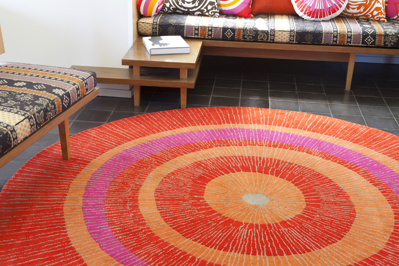 Eccentric Large Round Rug In Orange And Red By Not Neutral