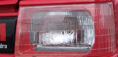 FRONT HEADLAMP COVER PLATE FOR 2615 MAHINDRA (19632655000)