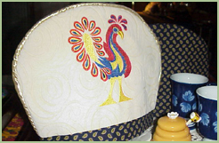 Country tea cozy with fantasy birds