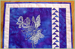 Quilt with Cutwork Butterflies