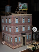 I attached a photo of my first model (0 scale) using your software.  It is 99.9% paper accept for the round sign hanging off the front of the building, which is a key chain.  I am very happy with the results, and am already designing my second!  <br> Thanks Jack