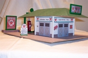 Here's my 2nd Model Builder Building (an adaptation of your Service Station Plans (with some bass wood additions ).   The Texaco wrecker truck is 1/43 scale, and so are the gas pumps as well. The signs I constructed from signs printed off the internet. Elliott <br> See