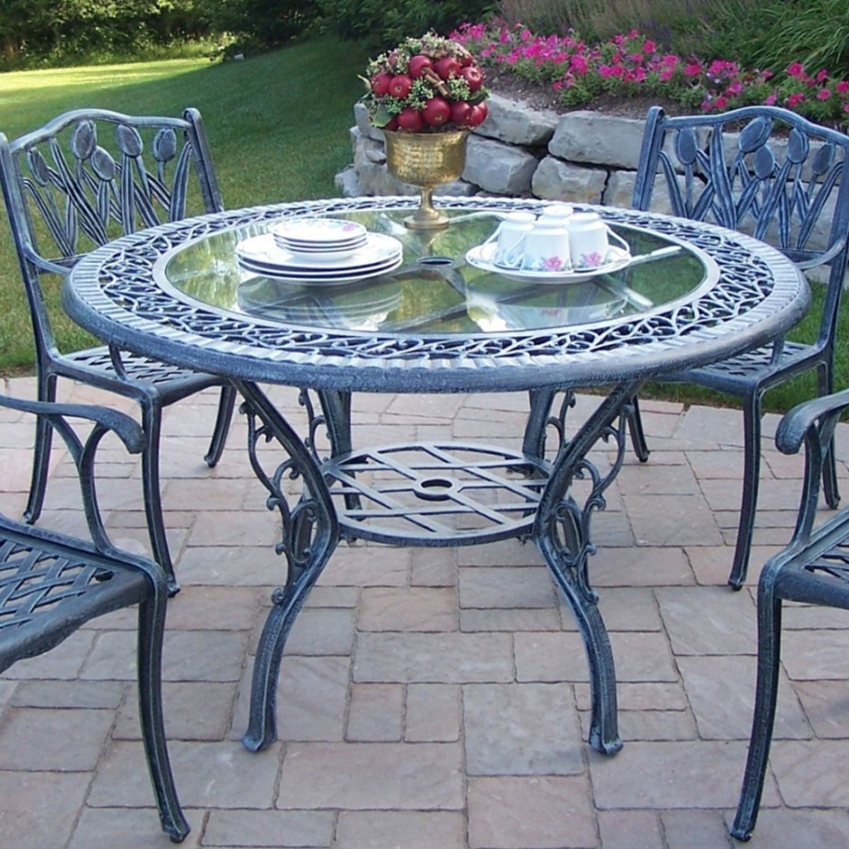 oakland living cast aluminum 48 round patio dining table with tempered glass top in antique. Black Bedroom Furniture Sets. Home Design Ideas