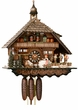 "CHALET CUCKOO CLOCKS:  21"" x 20"" BLACK FOREST WOMAN  8 DAY MOVEMENT"
