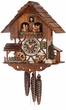 "CHALET CUCKOO CLOCK:  11"" WOOD CHOPPER  1 DAY MOVEMENT"