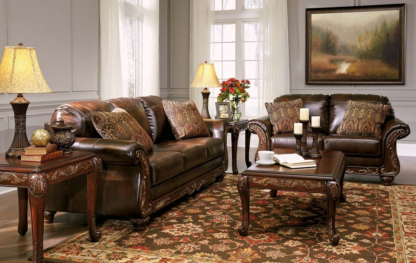 Vanceton brown leather traditional wood sofa loveseat for Upholstery living room furniture