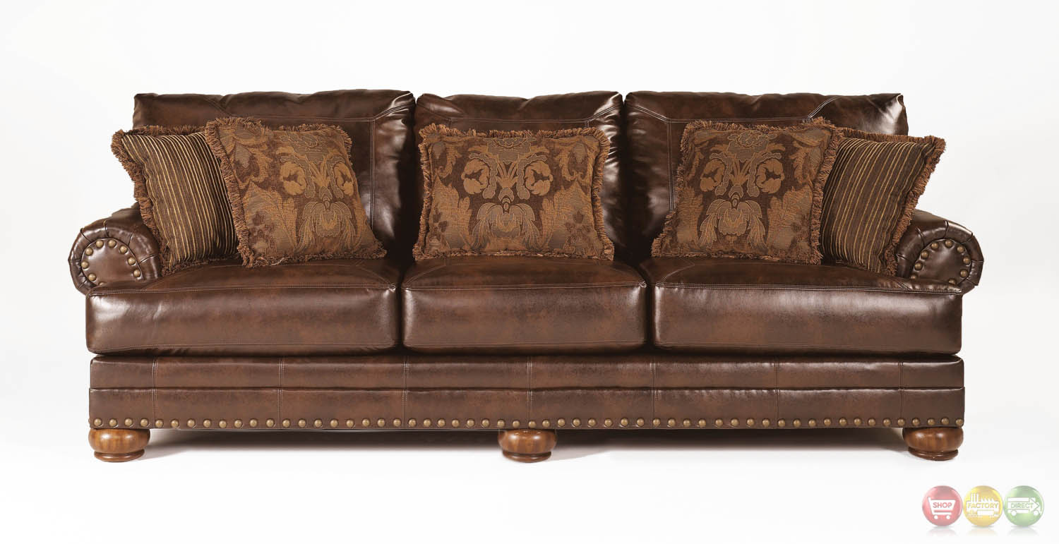 Ashley antique brown bonded leather sofa rolled arms for Best pillows for leather couch