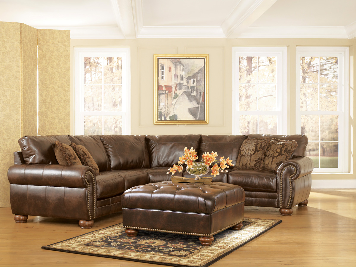 Durablend traditional antique brown sectional sofa by ashley for Brown leather sectional sofa ashley furniture