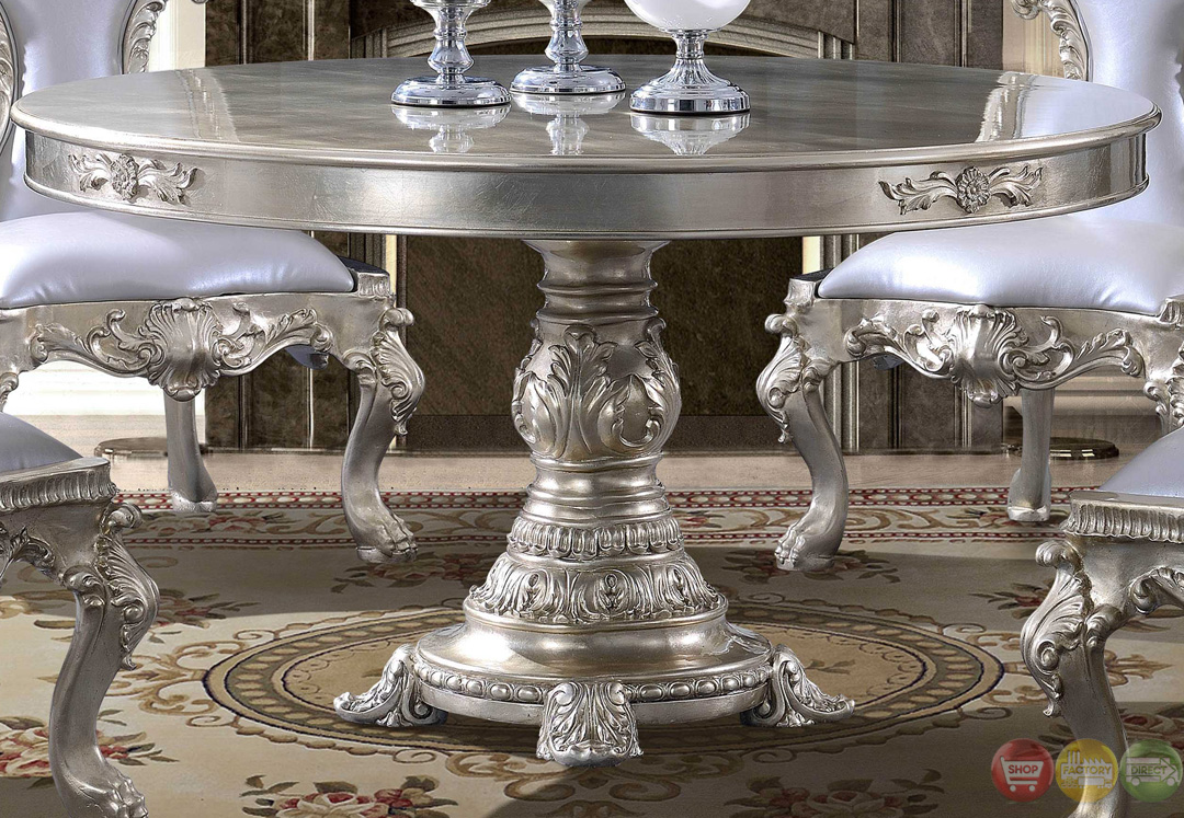 Formal dining room table with ornate bonded leather chairs for Fancy dining table set