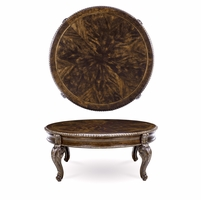 Gables Antique Cherry Round Cocktail Table With Carved Silver Details