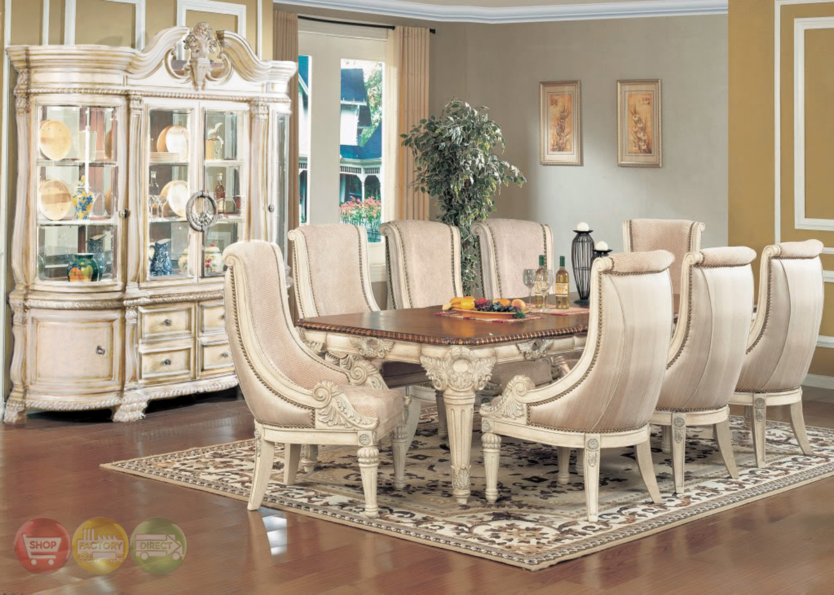 Halyn antique white formal dining room set with extension leaf for Antique dining room sets