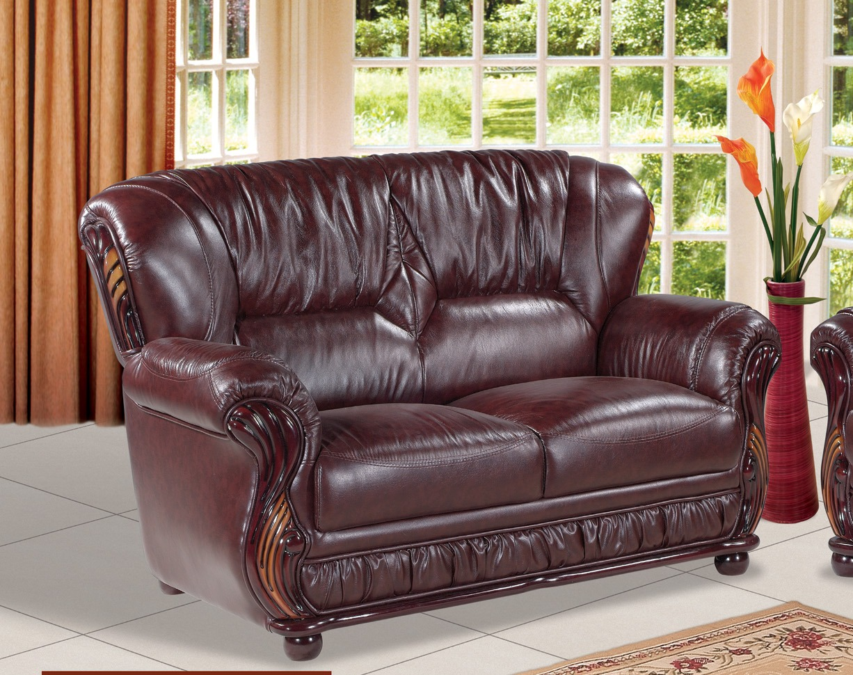 Mina burgundy leather loveseat with wood accents Burgundy leather loveseat