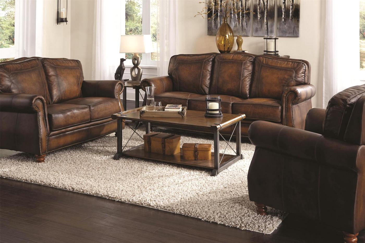 Montbrook traditional brown genuine leather sofa set for Brown leather couch with studs