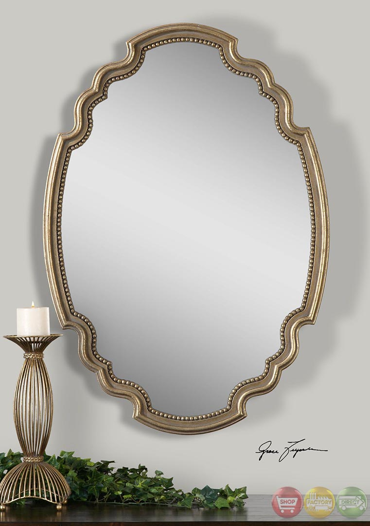 Terelle traditional lightly antiqued gold vanity oval for Traditional mirror