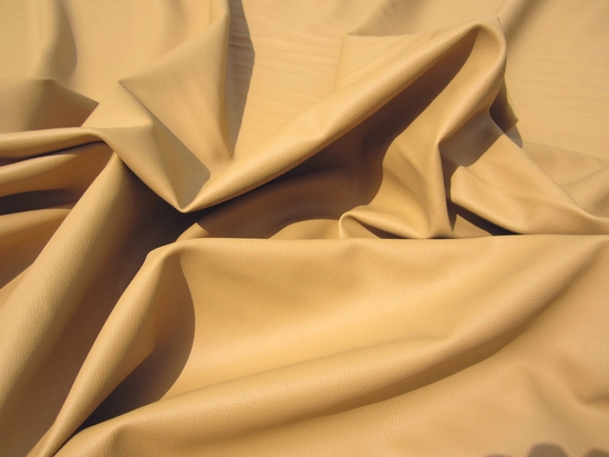 10 3/8 yards of J. Noble Intrepid faux leather color dune upholstery fabric