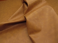 15 1/4 yards of tan, beige heavy vinyl upholstery fabric