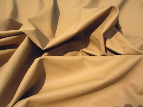 5 1/2 yards caramel grained vinyl upholstery fabric