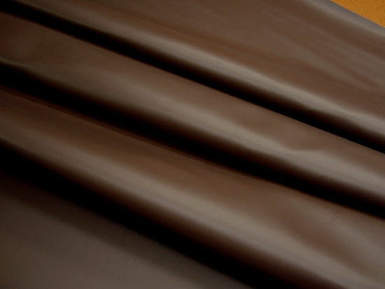5 1/2 yards of dark brown vinyl upholstery fabric
