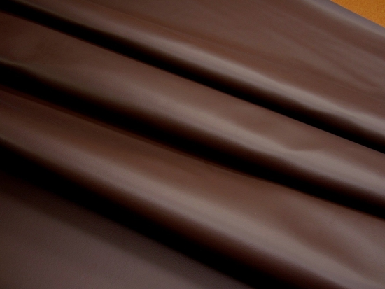 6 1/8 yards of dark brown grained vinyl upholstery fabric