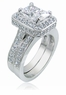 Elegant Emerald Cut Cubic Zirconia Pave Set Halo Cathedral Wedding Set with Matching Band