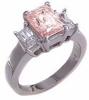 The Jen Ring Inspiration 1.5 Carat Pink Emerald Step Cut Cubic Zirconia Three Stone Solitaire Engagement Ring