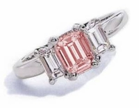 The Jen Ring Inspiration 1 Carat Pink Emerald Step Cut Cubic Zirconia Three Stone Solitaire Engagement Ring
