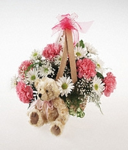 Basket arrangement with plush bear for a baby girl.