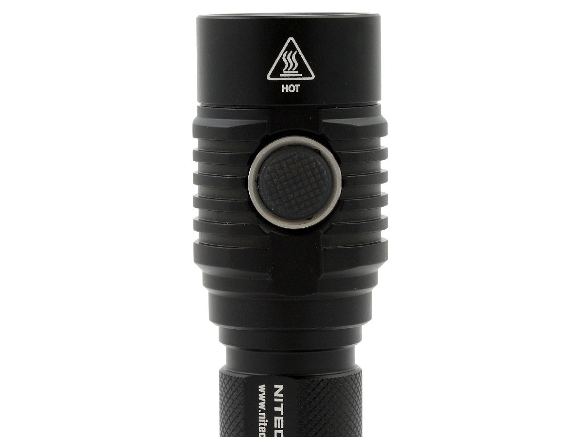 Nitecore MH23 flashlight with close up of side switch