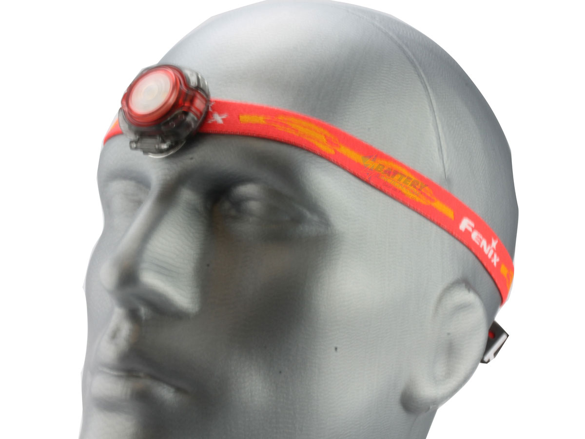 Fenix HL05 headlamp in red on head left side angle