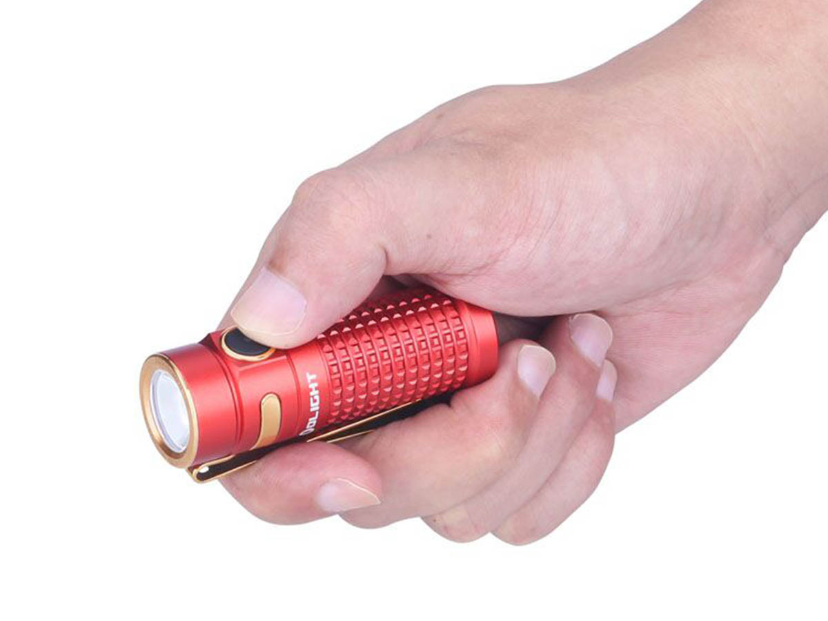 Olight S1R II Red gripped in hand