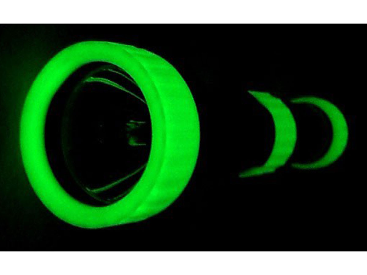 AE Light Xenide Rubber Hand Grip and Lens set glowing in the dark