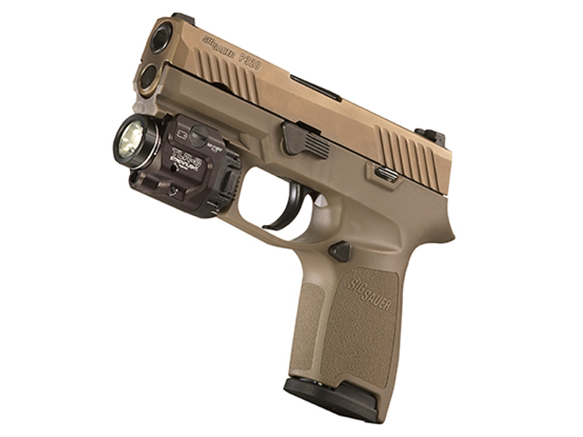 close up of streamlight tlr-8 mounted on handgun
