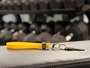 Yellow Cinch on gym bench