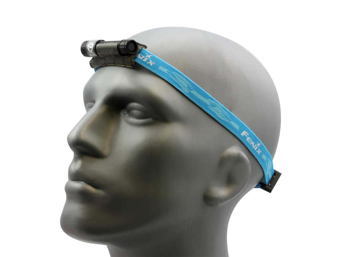 Fenix HL10 headlamp in black with blue headband on head left side angle
