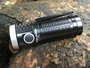 t1 flashlight, on a rock