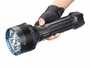 Search light in a gloved hand