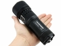 Tactical flashlight in a hand