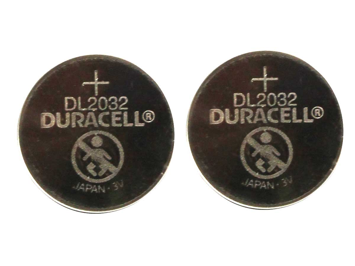 Front view of two Duracell CR2032 coin cells